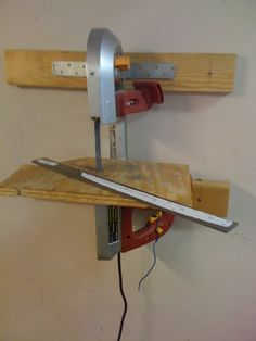 Wall mounted portable band saw. Shop Storage, Shop Organization, Carpentry Tools, Woodworking Projects, Portable Band Saw, Saw Stand, Diy Workbench, Diy Shops, Metal Working Tools