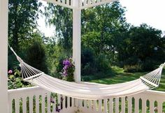 After nailing down beautiful landscaping ideas, you can decorate your backyard with a hammock chair, a portable hanging bed or maybe even two items