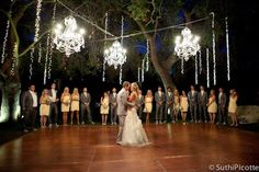 Love the chandeliers in the trees.