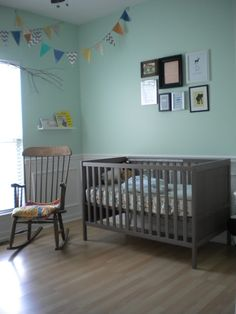 Baby Nursery, mint green walls, grey-brown Ikea furniture, fabric banner, book ledges, frame kids' art collage