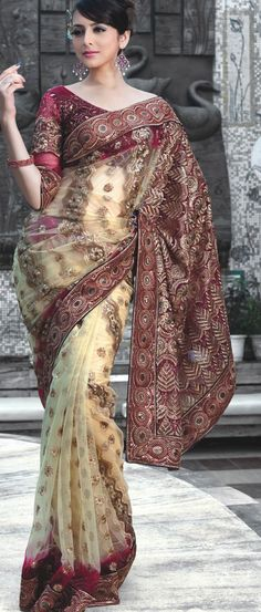 Fawn Net #Saree with #Blouse @ $56.73 | Shop @ http://www.utsavfashion.com/store/sarees-large.aspx?icode=srz198