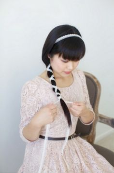 Tying lace around a simple ponytail is an easy bridal hair idea.