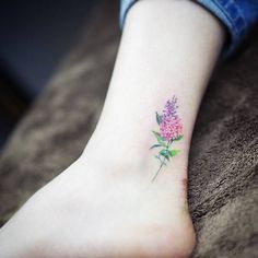 Watercolor style lilac on the ankle. Tattoo artist: Sol Tattoo