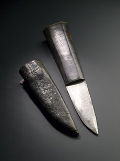 Sgian dubh, a small knife with horn grip and brass mount in leather sheath, probably for wearing in a stocking top with Highland dress: 19th century