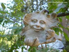 The Green Man is a common motif in garden art, this one is a wind chime...#rustic-garden-art