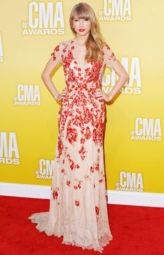 I LOVE this dress... the style, the red, the material... eeeeek! Taylor April 2012