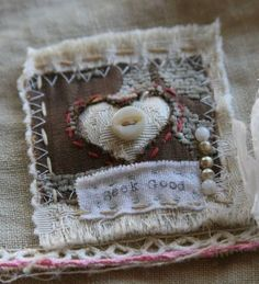 Sweet small fiber artwork with heart and mother of pearl button