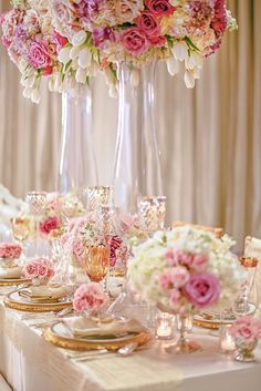 This luxurious tablescape featured golden plates and glassware, tall arrangements of white tulips, pink roses, and billowing blooms, as well as elegant candleholders on crystal stands. #TableScape #WeddingCenterpiece Photography: Carasco Photography. Read More:  http://www.insideweddings.com/weddings/a-regal-modern-ethereal-inspirational-wedding-shoot-in-chicago/667/