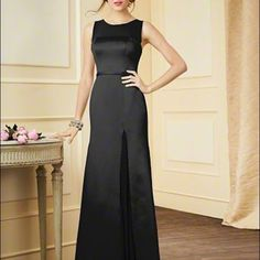 Black gown Beautiful black bridesmaid dress. Excellent used condition,worn once. Size 0, with altered hem and cups put in. Very pretty dress!! Alfred Angelo Dresses