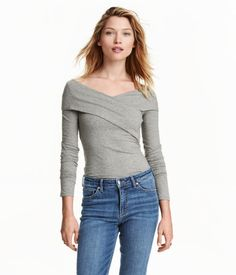 Gray melange. Fitted V-neck top in cotton jersey with long sleeves and wrapover…
