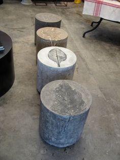 Concrete stools with leaf prints.