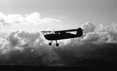 Cessna 140 NC89634 clouds