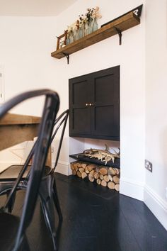Dark Cupboard With Shelf, Antlers And Firewood Stack - Boho Industrial Dining Room With Vintage Accents Rock My Style, Style Uk, Asos Home, Interior Ideas, Interior Decorating, Paint Charts, Column Radiators, Ikea Frames, Industrial Dining