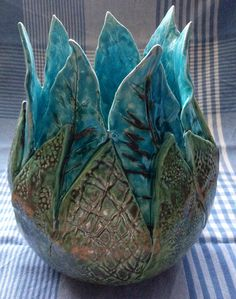 I do love the movement flowers and leafs give an object. Slab built textured pot
