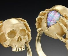 A unique hand made 'Memento Mori' ring in 18 karat yellow gold. Cleverly inlaid with a three-dimensional bas' relief carving of the human brain carved in Australian Fire Opal (source: Coober Pedy Mine) by the Gem Carver Sean Davis. The ring is hand chased and engraved with anatomical precision. Satin finished. #skulls