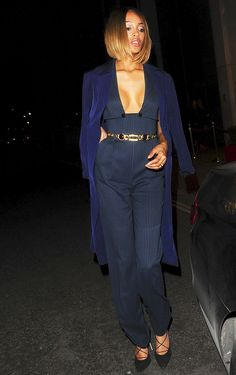 Jourdan Dunn in a sexy, low-cut and pinstripe belted jumpsuit
