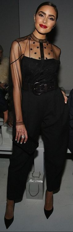 Who made Olivia Culpo's black mesh jumpsuit and clutch handbag?