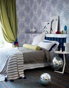 Mixing and matching different stripes, geometric patterns and florals gives this bedroom a contemporary edge.