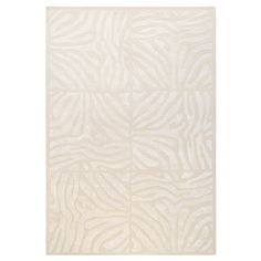 Anchor your living room seating group or define space in the den with this artfully hand-tufted New Zealand wool rug, showcasing a zebra-print tile motif for...