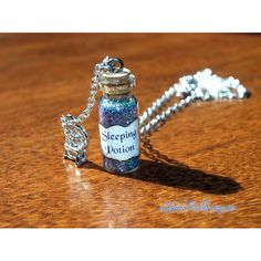 Sleeping Potion Necklace with Spinning Wheel Charm, Sleeping Beauty,... ($16) ❤ liked on Polyvore featuring jewelry, necklaces, charm necklace and charm jewelry