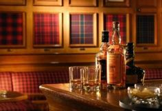 The Tartan Bar in Hong Kong. The framed tartan swatches are brilliant.