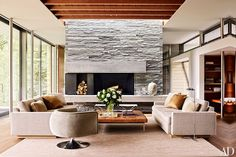 Fireplace.  A quartzite chimney breast defines one end of the open-plan living/dining/kitchen area.