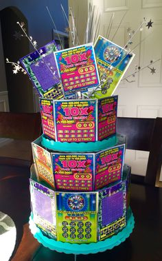 Lottery Cake- Birthday gift/Raffle ideas Made from scratch off Lottery tickets  and cardboard cupcake stand from party supply store.