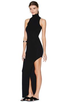 Vanish Maxi Dress: Smokin' hot black maxi dress featuring a high neckline and asymmetric hem. Super stretch fabric, unlined. Looks killer paired with a chained ear cuff and platform boots! (gotta be Nastygal.com)
