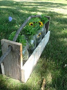This is pretty neat. Recycling barn wood and mason jars. Need more barn wood ideas? Check out the site below :)