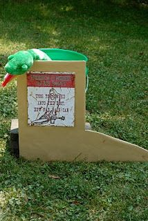 """""""there's a snake in my boot!"""" kids try to throw the snake into the boot (bucket). Keep moving the line back to see who can make it the farthest. Beth Kruse Custom Creations: jessie & woody (cowgirl/cowboy) party"""