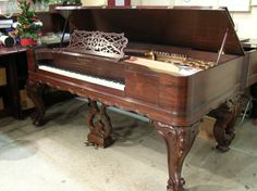 Antique Square Grand Piano...just like my moms.  Such a rich sound. No home should be without some kind of piano.