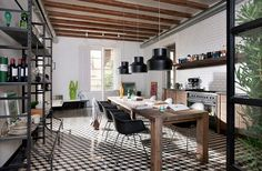 Kitchen and dining space neatly rolled into one. Loving the geometric cement tile on the floors! [Design: Egue y seta Architects]