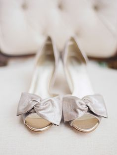 metallic bow heels Photography: Taylor Lord Photography - taylorlordphotography.com  Read More: http://www.stylemepretty.com/2014/06/11/eclectic-austin-wedding-pastel-hues/