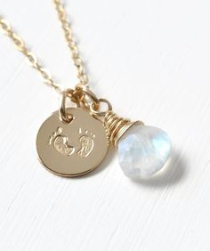Gold Fill Baby Footprints Necklace with June Birthstone.  Jewelry gifts for new moms by Blue Room Gems.
