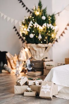 Small pile of gifts in the corner of a cozy room. Photo by viktoriaalisevich on Twenty20