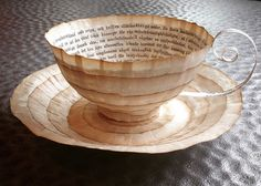 Old Books Repurposed Into Paper Cups And Saucers By Cecilia Levy | Bored Panda