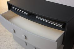 Clever repurpose. Removing the top drawer allows room for the components and turns it into a DIY entertainment center.