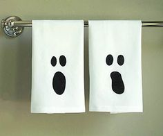 Your guests will get a surprise scare with these haunting bathroom towels.                 What you'll need: white hand towels, ghost template, painter's tape, craft knife, freezer paper (found at the grocery store), iron, black fabric paint, foam or stencil brush, scrap cardboard or plastic                 Make it: Print out the ghost template, tape it on top of freezer paper (shiny side facing down), and cut out the design with a craft knife. Once you've got your ghost face, press the…