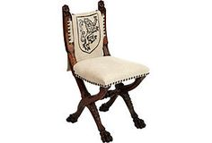 Lion Chair from One Kings Lane.  How about reupholstering a simple chair and stenciling your coat of arms?