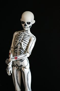 Look at that pure beauty: a skeleton boy BJD !!! This OOAK doll was painted by Melancholy Kitties. Here's her blog melancholy-kat.li... creepy