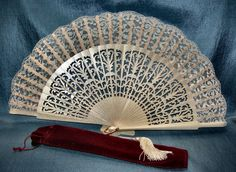 Bridal Fan - Absolutely stunning hand fan for the bride. Spanish Fan is made of wood with dainty carvings, finished with silk lace, light ivory color with tassel. Can also be used for bridesmaids and other special occasions. Comes with a burgundy velveteen case or white silky bag.