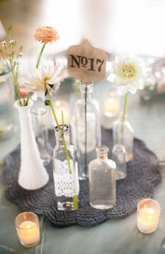 Deb, i want to make these for all over the cabin (the vases and flowers not the table number haha) , and i want to get married when the sun is setting, and have the cabin be lit by candle light.