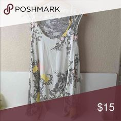 Asymmetrical tank Excellent condition  Size Med, but can fit a large Loose, lightweight, asymmetrical, slit open shoulder  Extra long tank with plenty of room Silky soft material  Geometric abstract design with light grey, pink, & yellow on off-white  Smoke/Pet free home  OFFERS WELCOMED Tops Tank Tops