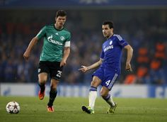 Chelsea's Cesc Fabregas (R) plays a pass alongside Schalke's Klaas-Jan Huntelaar (L) during during the UEFA Champions League, group G football match between Chelsea and Schalke 04 at Stamford Bridge, in London on September 17, 2014