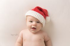 three month old girl smiling with christmas santa hat on - burlington baby photographer