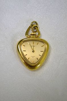 "Lovely Gold Tone ""Seiko - 17 Jewels"" Heart Shaped Pendant Watch - Manual Wind Up - 1"" Square"