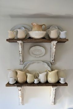 I would love a couple of shelves like this in my kitchen, holding a collection of vintage French latte bowls.