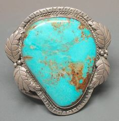 "Nevada Blue Turquoise Cabochon in Sterling Cuff.  From ""Turquoise Identification"" by Tucson Turquoise"