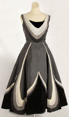 Black and tan full-skirted 1950s party dress with a full skirt that has a box-pleat front. Silk and velvet in graduated tones of amazing curved panels (?) By Fontana. Vintage Textile archives.