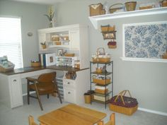 Cute craft room - love the Longaberger Baskets and the ribbon rack on the desk.